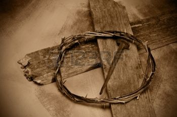 12893946-closeup-of-a-representation-of-the-jesus-christ-crown-of-thorns-cross-and-nail